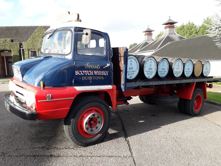 Vintage van carrying whisky casks at Glenfiddich Distillery,