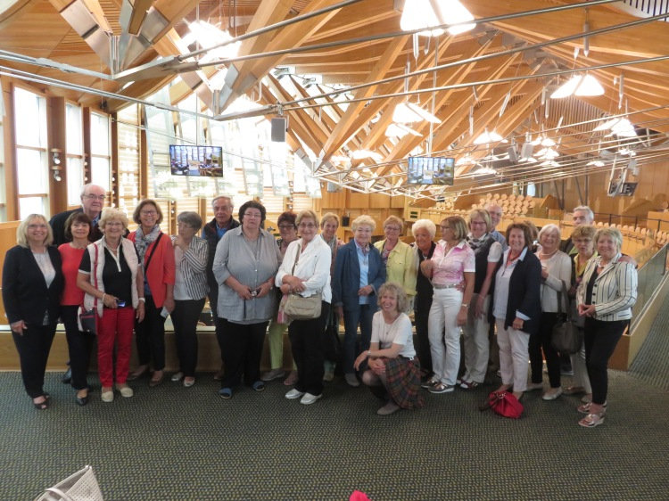 Group photo in debating chamber of Scottish Parliament in visitors area